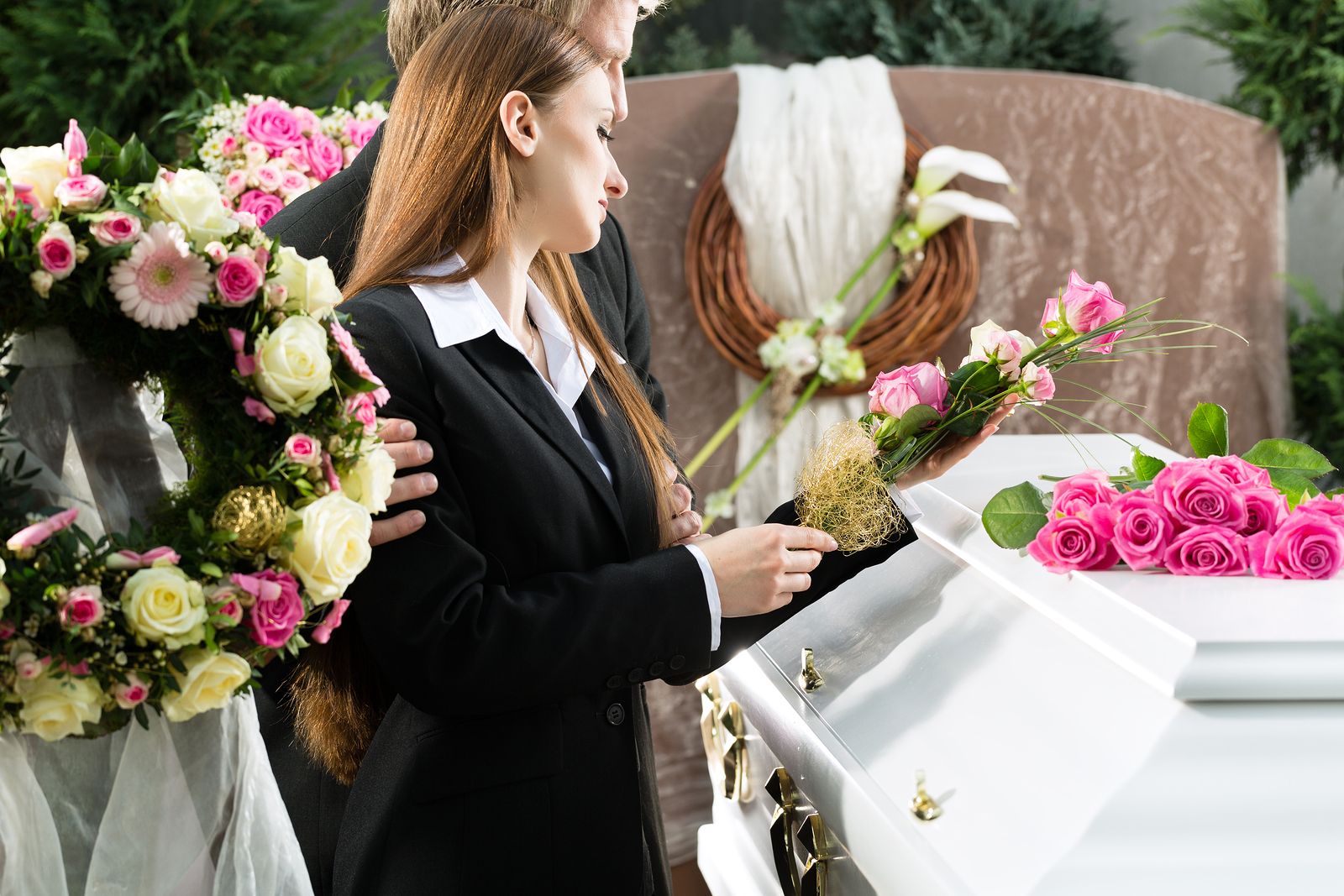 bigstock-Mourning-man-and-woman-on-fune-46029547
